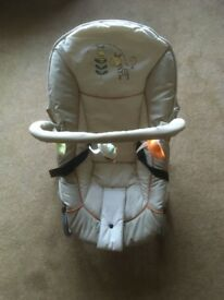 Hauck baby bounce chair with overhead mobile in excellent condition.