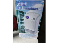 Mini Dehumidifier Used once as new for Quick sale moving home