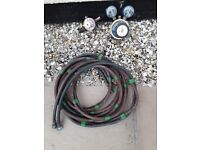 One set of oxygen and acetylene guages complete with hoses