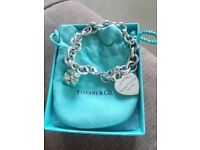 Tiffany bracelet with heart and present charm