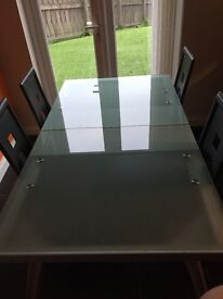 Glass dining table and black leather/chrome chairs