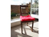 IKEA Stefan solid wood chair and red cushion