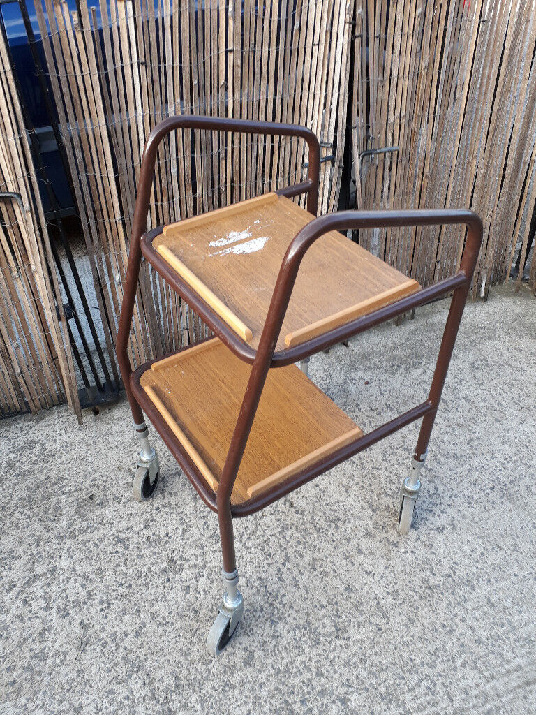 metal framed disability walker with 2 trays at the front