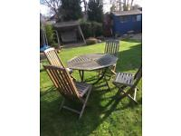 Folding garden table and chairs.