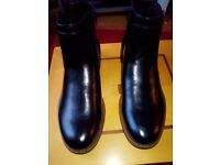 Brand new black Chelsea boots(men) size 10.5(US),9.5(UK).Stretch panel and side zip. Padded insole.