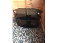 Oval black toughened glass TV stand as new ( can deliver )