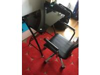 A black glass/metal desk with a chair
