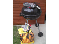 Barbeque with Utensils, 1/2 bag of charcol, some fire lighters & grilling basket, £25 for the lot!