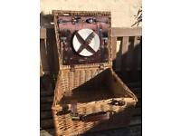 Wicker picnic basket with plates and cutlery