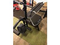Domyos home gym/weight bench and straight bar and weights