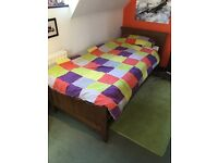 Single bed plus full size hideaway guest bed