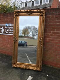 Large gold framed mirror. 183 x 93 cms