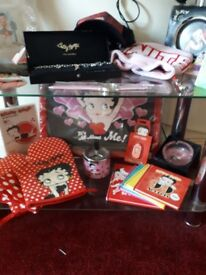 Collection of betty boop items vairying from bags, cups, lighters jewellery ornaments n other items