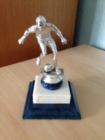 Silver Football Trophy on Blue Base