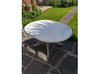 Extendable dining table and 4 chairs. Distressed look
