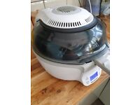 AIR FRYER WITH ROTATING PADDLE