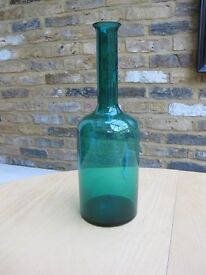 tall glass vase in green