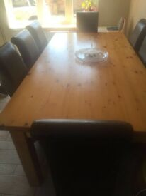 Large family pine dining table with 8 leather chairs