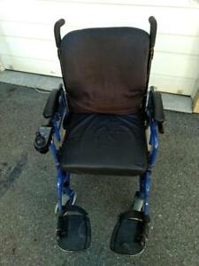 Power Wheelchair in good condition - complete with seat cushion