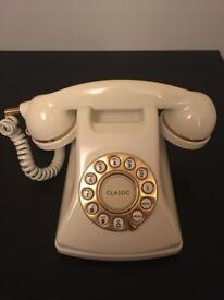 Cream retro working telephone