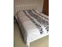 Kingsize white wooden bed