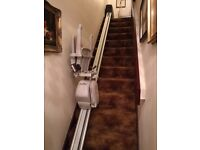 Acorn Straight stair lift with hand remote.