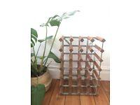 Minimalist wooden and metal wine rack. Hold 24 bottles