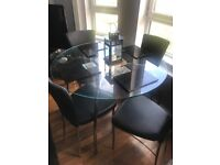 Glass Circular Dining table and 4 Black Leather Chairs