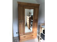 Antique wardrobe with centred mirror, carved detailing and lined interior