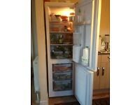 1 year old Newworld NWCOMW5517W Fridge & Freezer in White A+ energy rating