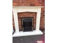 White marble and wood fireplace withelectric coal fire