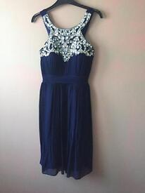 Lovely blue dress size 12, with gem detail