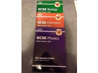 AQA GCSE Biology, Chemistry and physics revision guides.