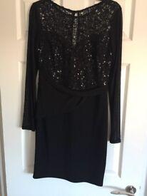 Black Lipsy bodycon dress. Size 12. Unworn