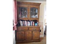 Dark Oak Display Cabinet. Leaded Glass Doors top, 2 drawers & 2 cupboard doors in base.