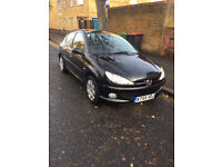 Metallic Black Peugeot 206, low mileage and great condition