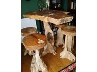 Solid teak tree root patio table and stools