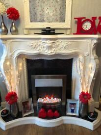 Beautiful solid & very heavy fire surround & electric fire