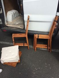 IKEA dining table and four chairs with covers