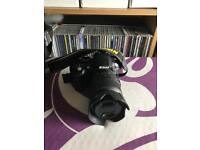 NIKON DSLR 3100 with 18-55mm Lens and Lowepro Bag.