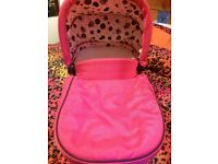 Pink carrycot .