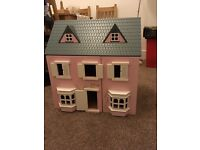 Beautifully made Dolls House with furniture for 5 rooms.