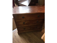Chest of drawers , 3 good sized drawers , original handles . Solid wood back .