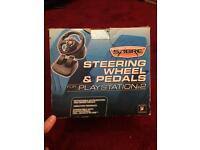 2 boxed playstation 2 steering wheels