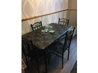 Black and grey table and chairs in vgc comes from smoke and pet free home £55