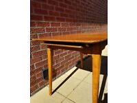 Mid century extendable dining table