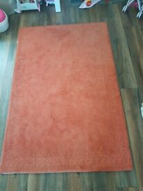 Large orange/rust wool rug