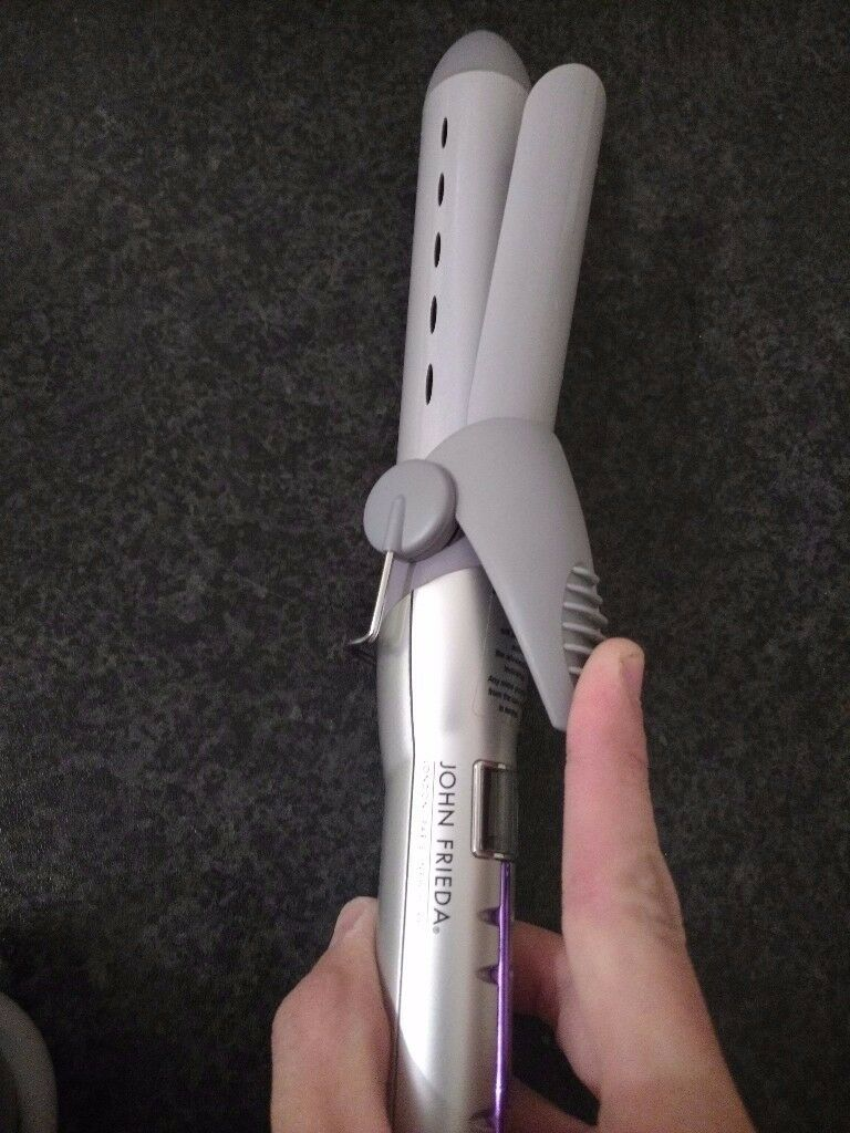 As new curling iron john frieda
