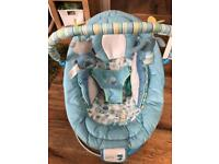 Vibrating bouncy chair with music