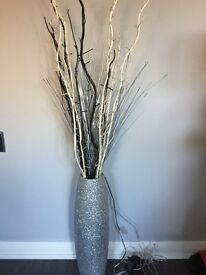Silver glitter vase with light twigs